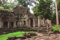 Tower, huge trees and galleries in Preah Khan Temple. Tower, huge trees and galleries at sunny morning in Preah Khan Temple, Siem Reap, Cambodia Stock Image
