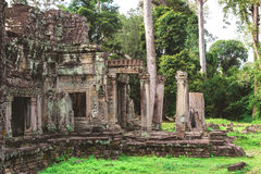 Tower, huge trees and galleries in Preah Khan Temple. Tower, huge trees and galleries at sunny morning in Preah Khan Temple, Siem Reap, Cambodia Royalty Free Stock Photography