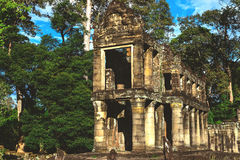 Tower, huge trees and galleries in Preah Khan Temple. Tower, huge trees and galleries at sunny morning in Preah Khan Temple, Siem Reap, Cambodia Royalty Free Stock Images