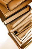 The 'Tower' of Knowledge. Toned image of large stack of books on white background stock photos