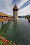 Tower on lake. A watchtower on lake in Lucerne and the covered transition decorated by colors Stock Photography