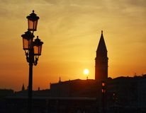 Tower and lamps in Venice, Italy Stock Image