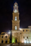 Tower of Lecce Cathedral at night, iconic landmark in Salento Stock Photo