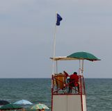 Tower with lifeguards for beach during the choppy sea in summer Royalty Free Stock Images