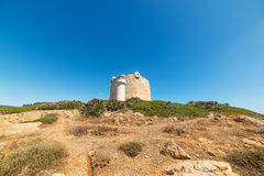 Tower and lighthouse. Lighthouse and Aragonese tower in Porto Conte, Sardinia Royalty Free Stock Image
