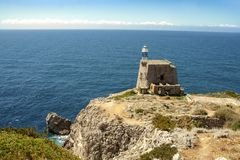 The tower and lighthouse of Punta Campanella at Sorrento. The tower and the lightscape of Punta Campanella at Sorrento, and landscape of sorrento`s peninsula and stock images