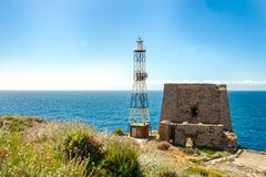 The tower and lighthouse of Punta Campanella at Sorrento. The tower and the lightscape of Punta Campanella at Sorrento, and landscape of sorrento`s peninsula and stock image