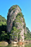 Tower like mountain in lake, Fujian Taining, China. Danxia landform mountain like tower with lake as featured physiognomy locate in Taining, Fujian province Royalty Free Stock Photography