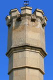 Tower from limestone blocks with lamp on top Stock Photo