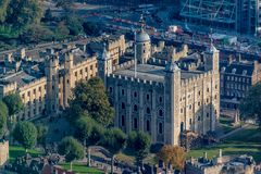Tower of London aerial view showing the white tower. Tower of London on the banks of the thames aerial view showing the white tower stock photo