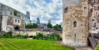 The Tower of London and the city district with Gherkin skyscraper, the UK. royalty free stock image