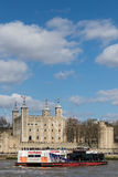 Tower of London and cruise ship. LONDON, UK - MARCH 25, 2016: Cruise ship by Tower of London Royalty Free Stock Photography