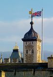 Tower of London detail. With the Royal Standard and Union Flag.  Focus on Royal Standard and Union Jack Stock Images