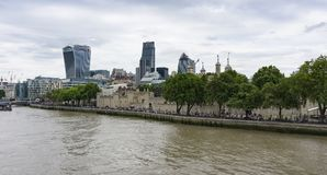 Tower of London in London, England, wide angle view from over River Thames. The Tower of London in London England, view angle from south bank of River Thames stock image