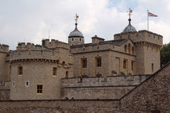 Tower of London. Her Majesty's Royal Palace and Fortress, known as the Tower of London, is a historic castle located on the north bank of the River Thames in Stock Image