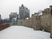 The Tower of London and London Bridge in the Snow. View of the outer wall of the Tower of London and London Bridge in the snow Stock Photos