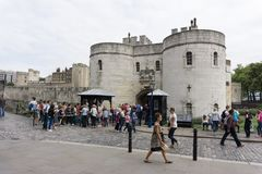 Tower of London in London, England, tourists at main entrance gate. royalty free stock image