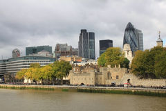 Tower of London and Modern London city office skyline by River Thames Royalty Free Stock Photography