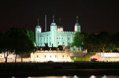 Tower of London at Night. Looking over the River Thames to the brightly illuminated Tower of London at Night Stock Images