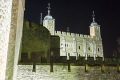 Tower of London at night. Her Majesty's Royal Palace and Fortress, known as the Tower of London, is a historic castle located on the north bank of the River Royalty Free Stock Photo