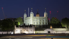 Tower of London at night, UK. Tower of London at night with light trails on Thames Stock Image