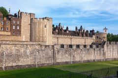 Tower of London outer curtain wall detail. The outer curtain wall and dry moat of Tower of London - historic castle and popular tourist attraction on the north Royalty Free Stock Photos