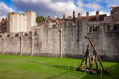 Tower of London outer curtain wall detail. The outer curtain wall and dry moat of Tower of London - historic castle and popular tourist attraction on the north Royalty Free Stock Images
