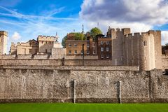 Tower of London outer curtain wall detail. The outer curtain wall and dry moat of Tower of London - historic castle and popular tourist attraction on the north Stock Photography