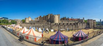 Tower of London panorama. London, England - August 5, 2018: Exterior features and buildings within Tower of London. The Tower of London is a Norman fortress and royalty free stock photos