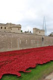 Tower of London and poppy installation. Art installation Blood Swept Lands and Seas of Red at the Tower of London, marking one hundred years since the first full Stock Image