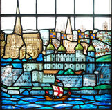 Tower of London on stained glass window. Stained glass window at the medieval church of All Hallows by the Tower in London. A sailship passes in front of the royalty free stock photos