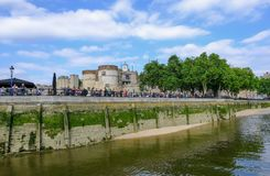 Tower of London taken from the River Thames at low tide on a sunny summer afternoon. Tower of London, London, UK - June 8, 2018: View of the Tower of London from royalty free stock images