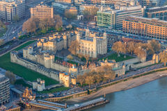 Tower of London. A view from sky of Tower of London during sunset with yellow light and river Thames Stock Photography