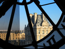 Tower of Louvre through Orsay clock Stock Image