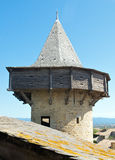 Tower with machicolation. Tower of alertness of the Castle of the Cite of Carcassonne with machicolation of wood stock photo