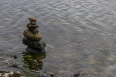 Tower of stone in water Stock Image