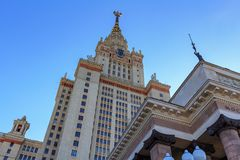 Tower of main building of Lomonosov Moscow State University MSU against blue sky in sunny summer evening Royalty Free Stock Image