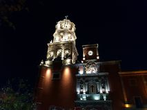 Tower of main catholic church in Querétaro, Mexico. View at night, located in the State of Queretaro, architecture and ancient construction, city with royalty free stock image