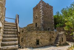 A tower in Mani in Greece. The Towers of Mani are military hallmarks. The need of fortifying the Mani home with a tower was the centralization and the Royalty Free Stock Image