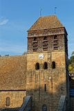 Tower of the medieval Abbey church of monastery in Saint-Chef royalty free stock images