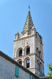The tower of the medieval church behind the wall Royalty Free Stock Image