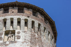 Tower of medieval italian castle on blue sky.  Royalty Free Stock Images
