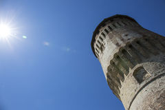 Tower of medieval italian castle on blue sky Stock Images