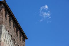 Tower of medieval italian castle on blue sky Stock Photo