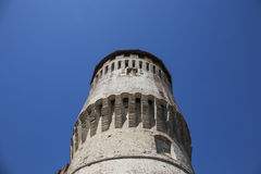 Tower of medieval italian castle on blue sky Stock Photography