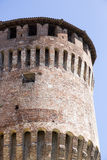 Tower of medieval italian castle on blue sky Stock Image