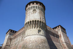 Tower of medieval italian castle on blue sky Royalty Free Stock Photos