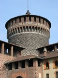 Tower of medieval Sforza Castle, Milan, Italy. Tower of medieval Sforza Castle with clear blue sky in warm and sunny spring day: MILAN MILANO, LOMBARDY LOMBARDIA Royalty Free Stock Photo