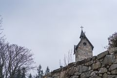 The tower of the Wang Temple in Karpacz. The tower of the medieval Wang Temple in Karpacz, Poland, photographed in winter. It is a Norwegian stave church which Stock Photography