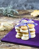 Tower of milk spring cookies with lavender in form of flower for women`s day, mother`s day, 8 march and grandmother`s day. Tower of milk spring cookies with Stock Image